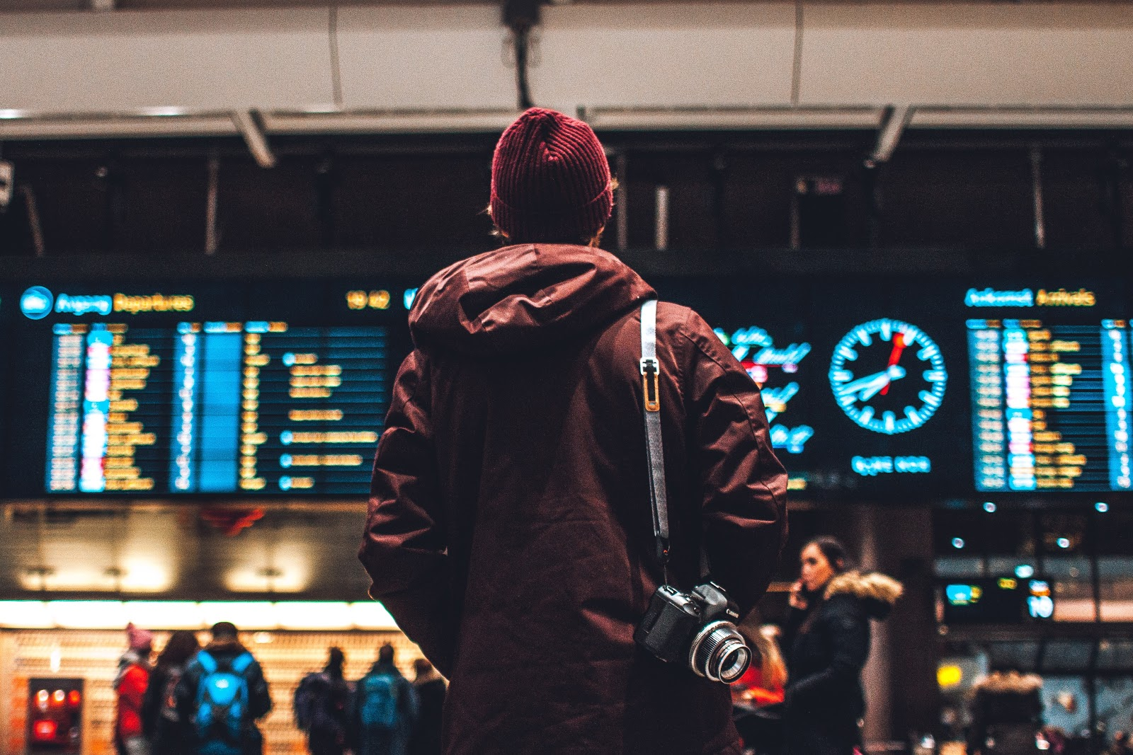 traveler scanning flight announcements