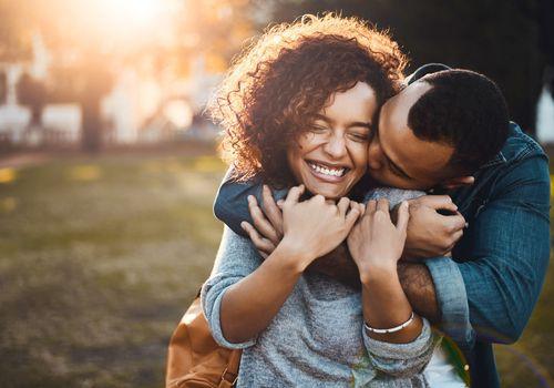 A happy couple hugging